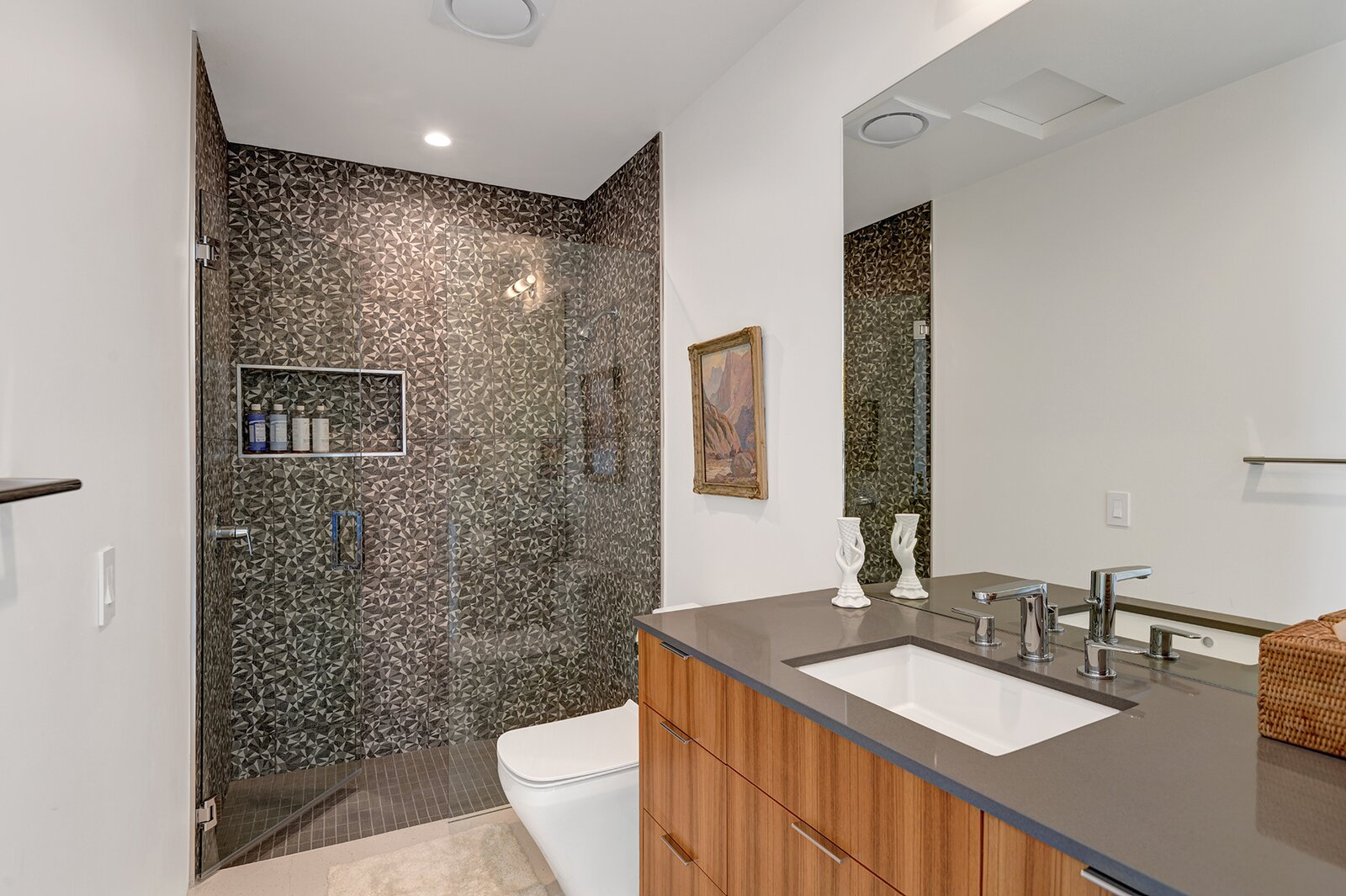 Each of the three full bathrooms share similar finishes, added during the 2019 renovation.  Photo 15 of 17 in A Palm Springs Alexander Home Sings After a Chic Renovation and Hits the Market to the Tune of $2.1M