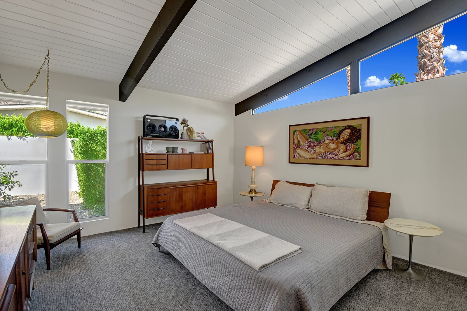 A look at one of the home's two secondary bedrooms.  Photo 14 of 17 in A Palm Springs Alexander Home Sings After a Chic Renovation and Hits the Market to the Tune of $2.1M