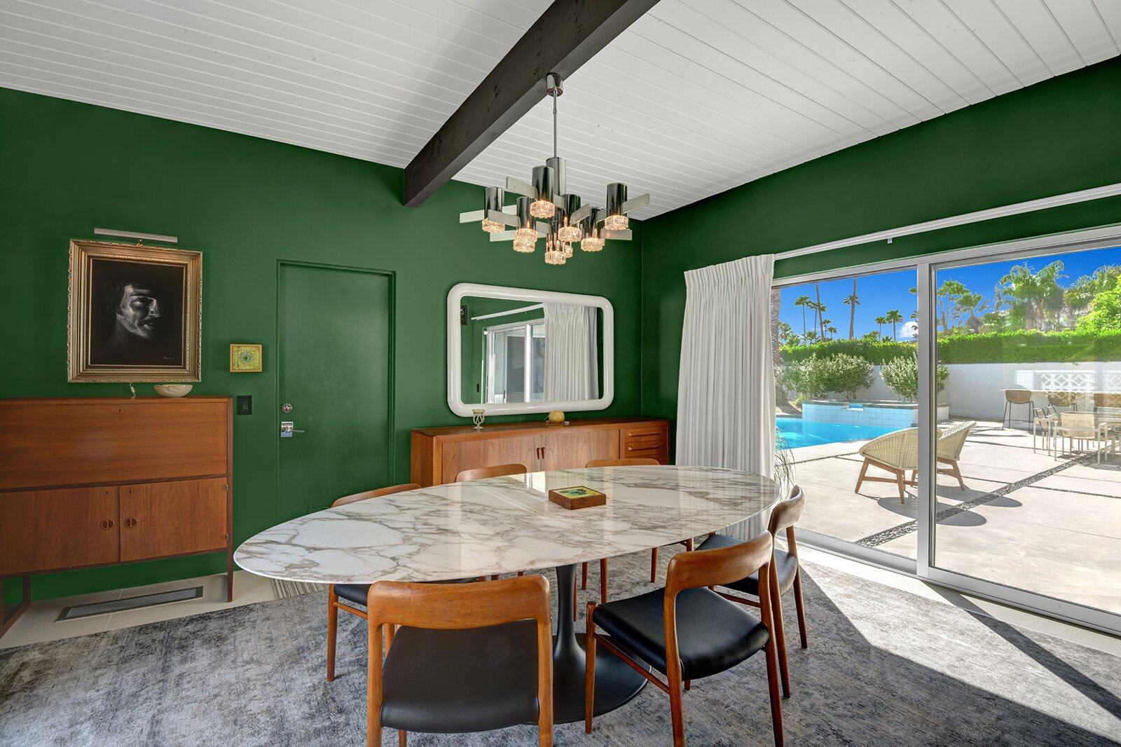Like most rooms in the home, the sunlit dining area provides direct access to the patio.  Photo 8 of 17 in A Palm Springs Alexander Home Sings After a Chic Renovation and Hits the Market to the Tune of $2.1M
