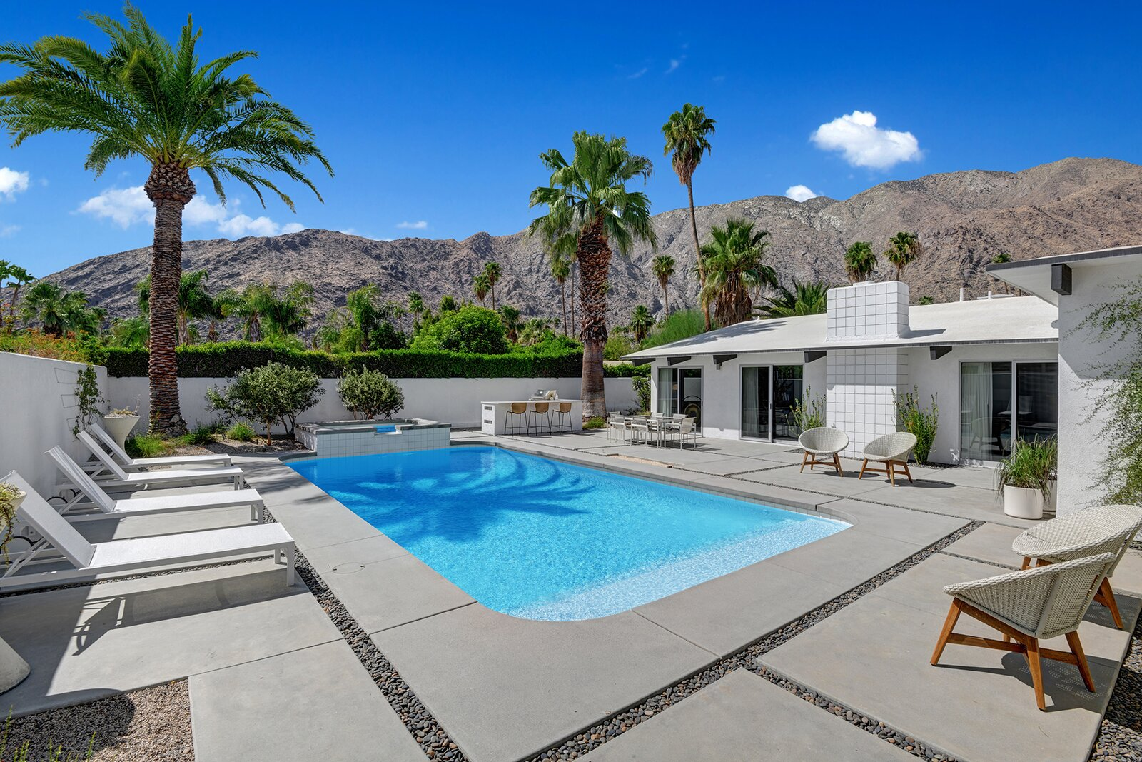 Outside, a sparkling pool and sunny patio await.  Photo 9 of 17 in A Palm Springs Alexander Home Sings After a Chic Renovation and Hits the Market to the Tune of $2.1M