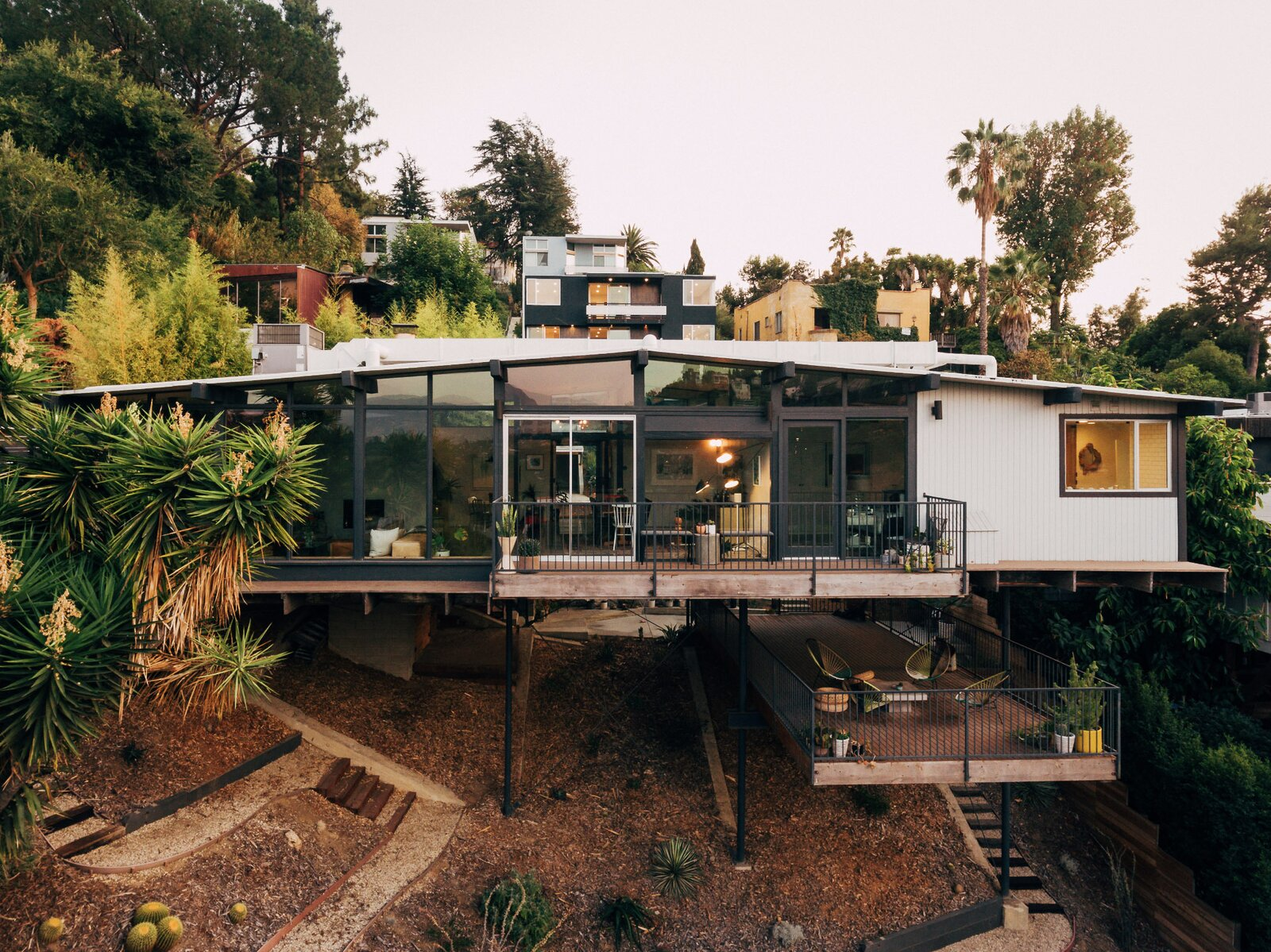 Reportedly one of the first homes built in the neighborhood, this recently listed post-and-beam dwelling is perched along a hillside lot in the Silver Lake area of Los Angeles. The 1962 structure was renovated in 2014 by the team at Tradecraft Real Estate Renovation.  Photo 1 of 16 in Raised on Stilts, a $2.5M Midcentury in Los Angeles Captures Beguiling Views