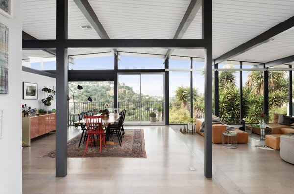 Inside, a two-level living and dining area features floor-to-ceiling windows that welcome in abundant sunlight.
