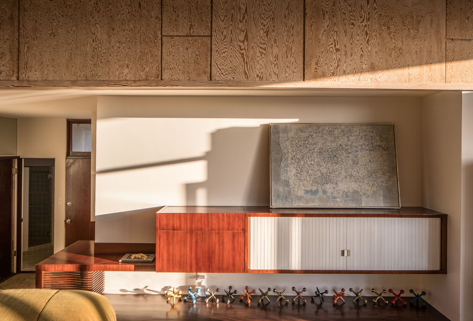 Another view of the penthouse living area provides a closer look at an original built-in cabinet along one wall.  Photo 3 of 14 in A Newly Restored Schindler Building Lists for $3.65M in L.A.