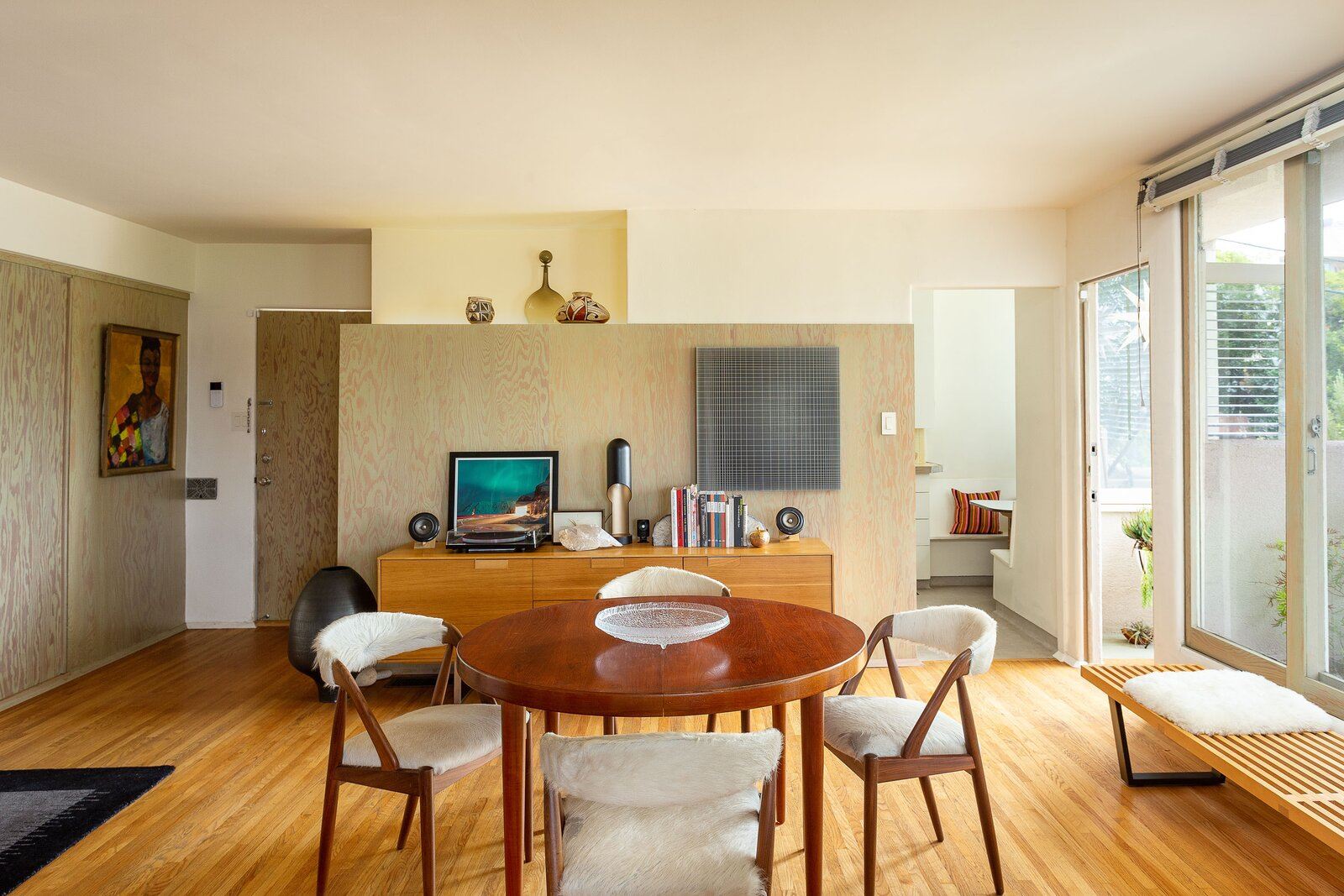 The sunlit unit also comes with its own outdoor space, accessible from a central dining area.  Photo 11 of 14 in A Newly Restored Schindler Building Lists for $3.65M in L.A.