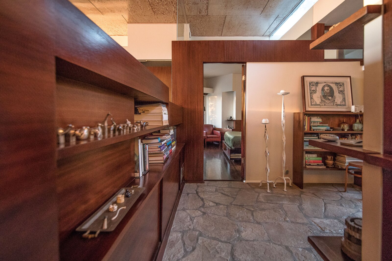 The entryway leads into a study outside of the bedroom.  Photo 7 of 14 in A Newly Restored Schindler Building Lists for $3.65M in L.A.