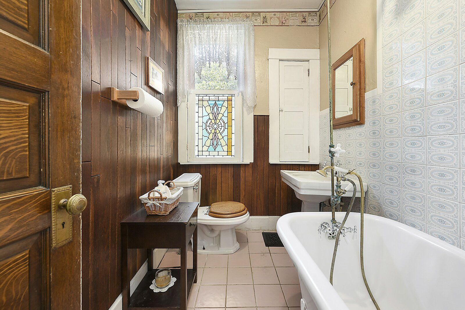 "The charming full bathroom features a clawfoot tub, pedestal sink, and stained glass window.  Photo 13 of 23 in Hey, Horror Movie Buffs—You Can Own the ""Silence of the Lambs"" House for $299K"