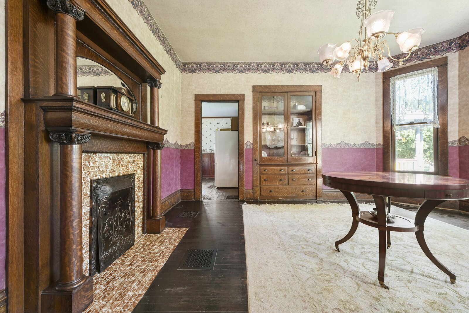 """Although home's intricate fireplace and built-in china cabinet were visible in the movie, the spacious room is otherwise neat and tidy today.  Photo 8 of 23 in Hey, Horror Movie Buffs—You Can Own the """"Silence of the Lambs"""" House for $299K"""