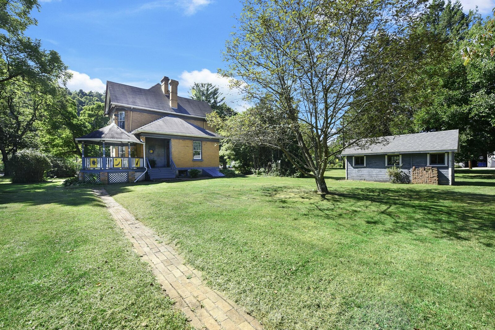 "Around back, an attached gazebo is accessible from a small porch near the kitchen. The property also comes with several detached structures.  Photo 19 of 23 in Hey, Horror Movie Buffs—You Can Own the ""Silence of the Lambs"" House for $299K"