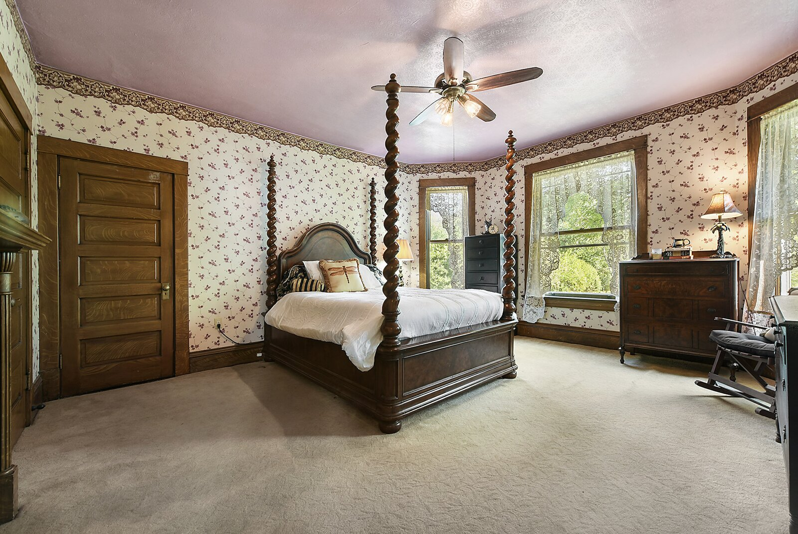 """Upstairs, the home offers four bedrooms but only one full bathrooms. This bedroom features a fireplace, several closets and a bay of windows overlooking the surrounding property.  Photo 12 of 23 in Hey, Horror Movie Buffs—You Can Own the """"Silence of the Lambs"""" House for $299K"""