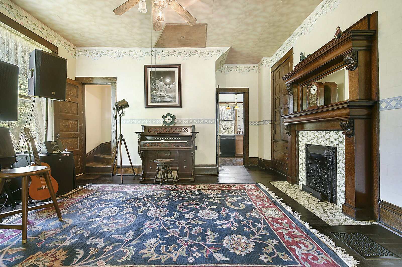 """Tracing the floor plan back around toward the front of the home, a music room is located on the opposite side of the wall from the dining area and is also accessible from the kitchen.  Photo 10 of 23 in Hey, Horror Movie Buffs—You Can Own the """"Silence of the Lambs"""" House for $299K"""