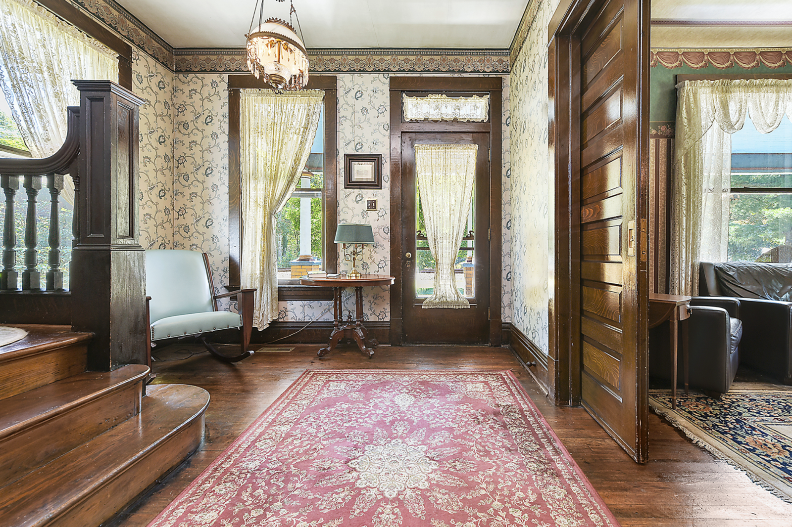"""A look at the foyer today reveals similar, although not the same, wallpaper as in the movie. The traditional layout features a large sitting room to one side, separated by large pocket doors.  Photo 5 of 23 in Hey, Horror Movie Buffs—You Can Own the """"Silence of the Lambs"""" House for $299K"""