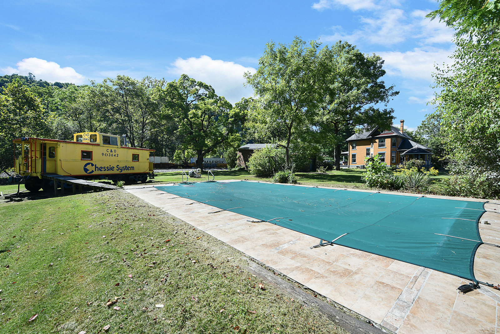 "A vintage train caboose nods to the property's past and serves as a pool house of sorts.  Photo 21 of 23 in Hey, Horror Movie Buffs—You Can Own the ""Silence of the Lambs"" House for $299K"