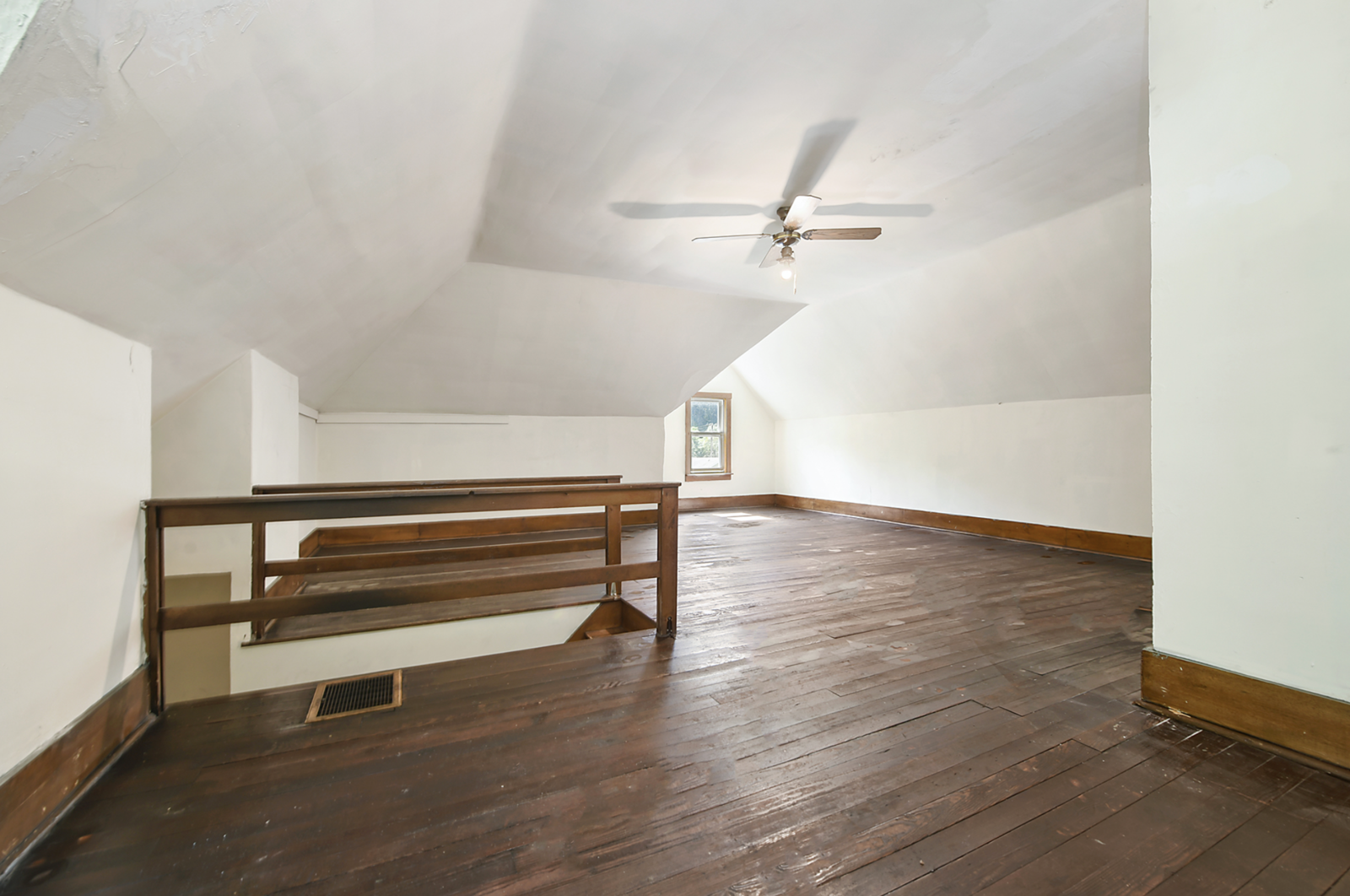"""A look at the sunlit attic space, which features newly refinished hardwood floors.  Photo 15 of 23 in Hey, Horror Movie Buffs—You Can Own the """"Silence of the Lambs"""" House for $299K"""