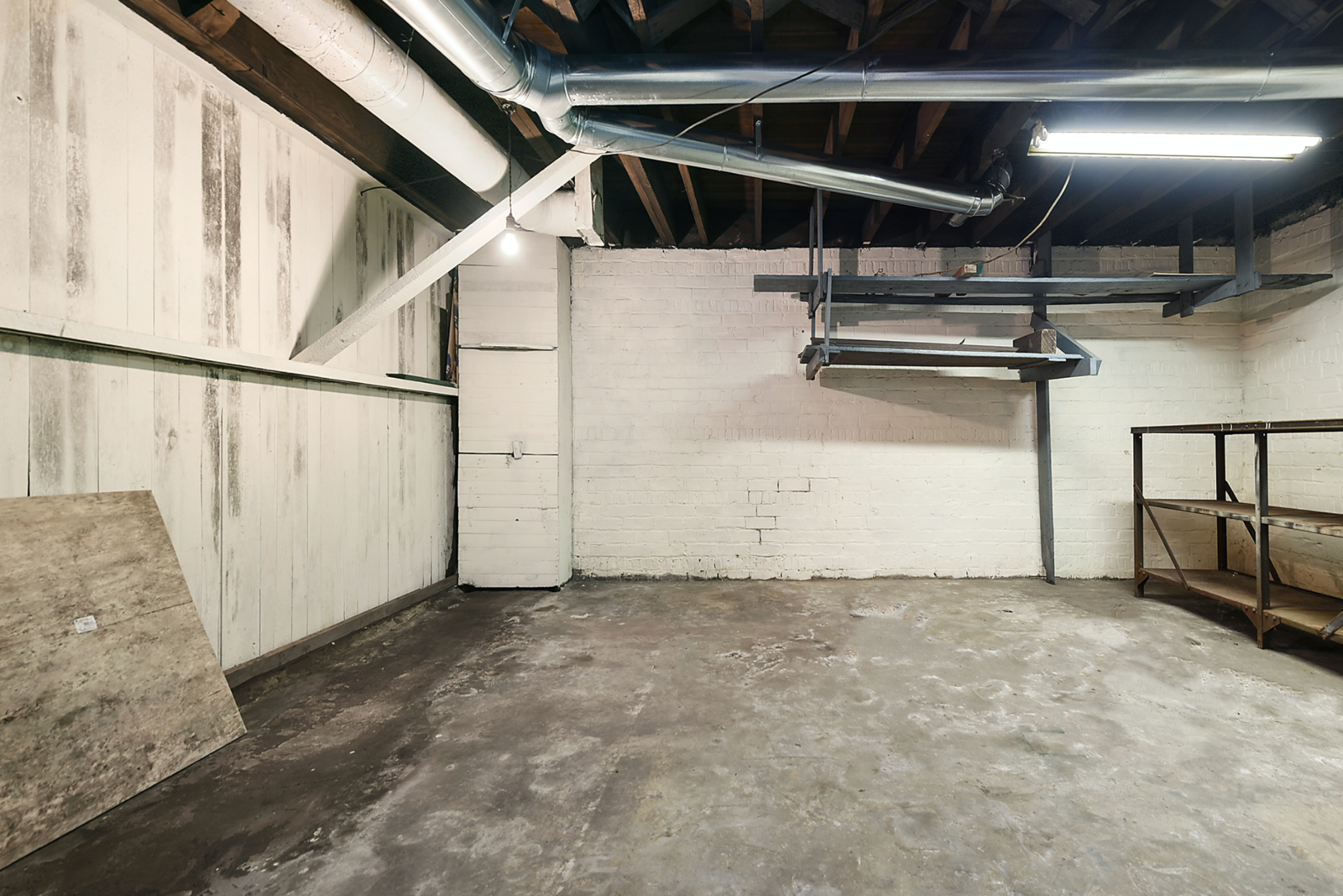 """No creepy rock well or dungeon in sight, the home's basement provides several large areas for storage.  Photo 16 of 23 in Hey, Horror Movie Buffs—You Can Own the """"Silence of the Lambs"""" House for $299K"""