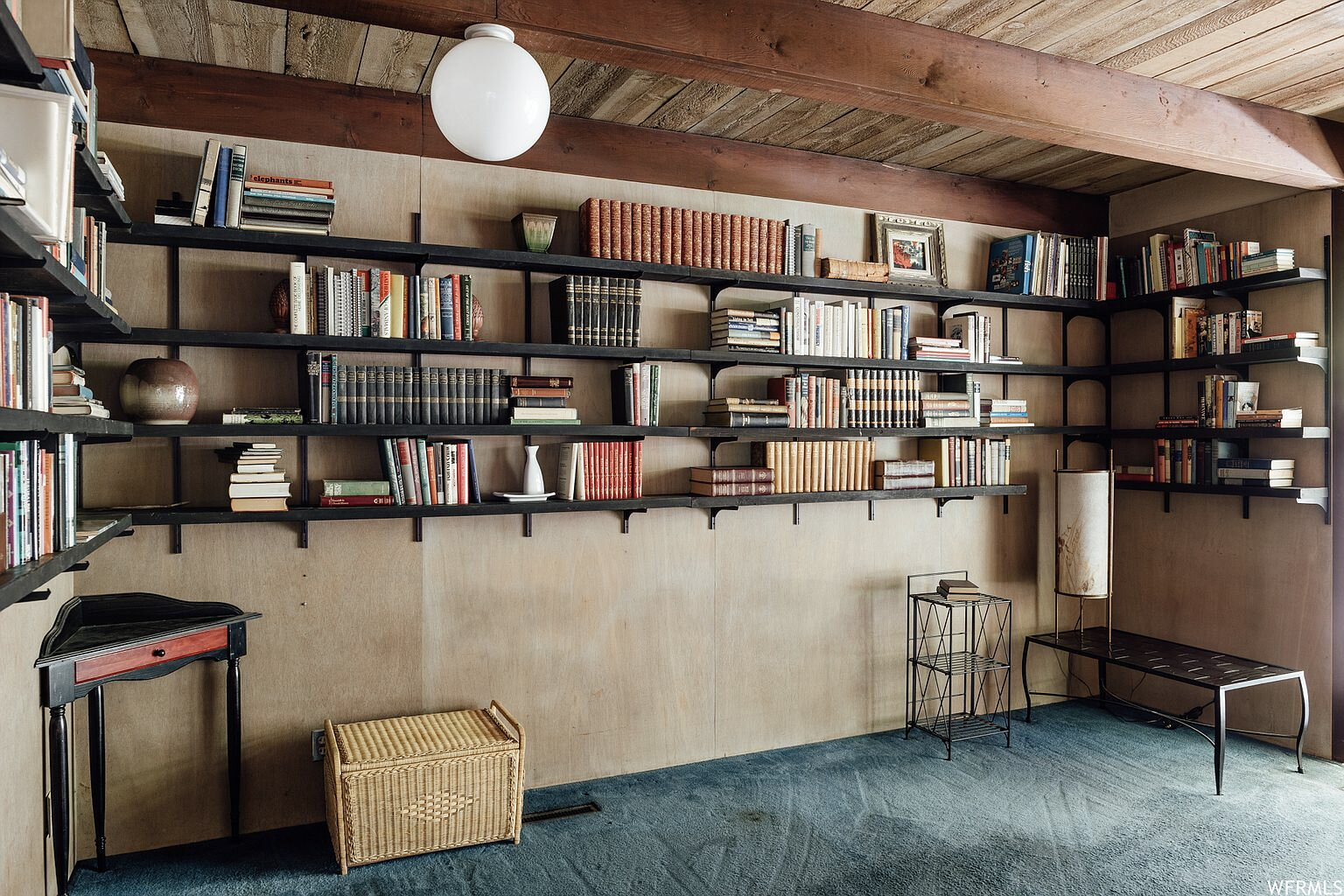 Another of the bedrooms comes complete with walls of built-in bookshelves.  Photo 13 of 18 in This Tranquil, Japanese-Inspired Midcentury Home Asks $1.2M