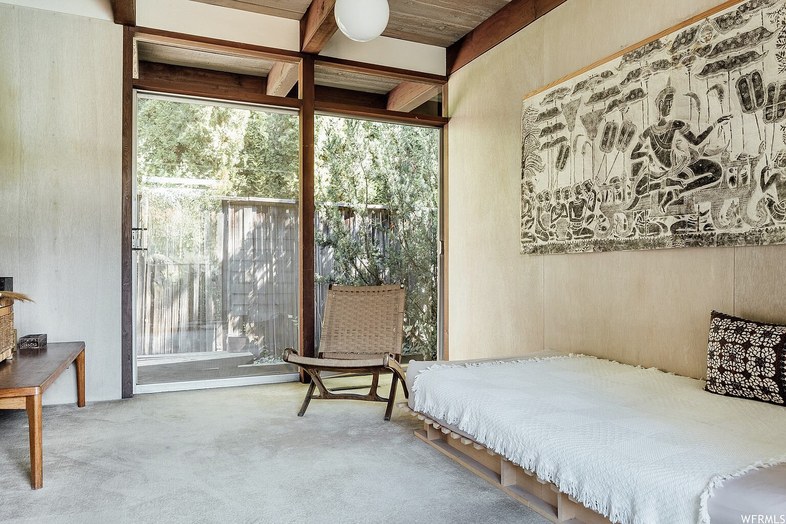 Several of the secondary bedrooms also provide direct access to a side area of the yard.  Photo 14 of 18 in This Tranquil, Japanese-Inspired Midcentury Home Asks $1.2M
