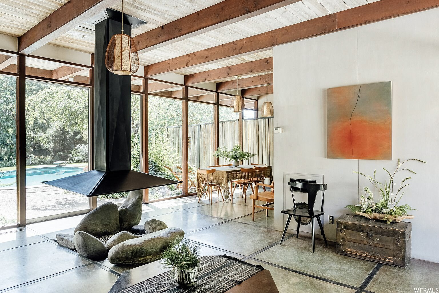 The living area also flows into a sunlit dining area.  Photo 4 of 18 in This Tranquil, Japanese-Inspired Midcentury Home Asks $1.2M