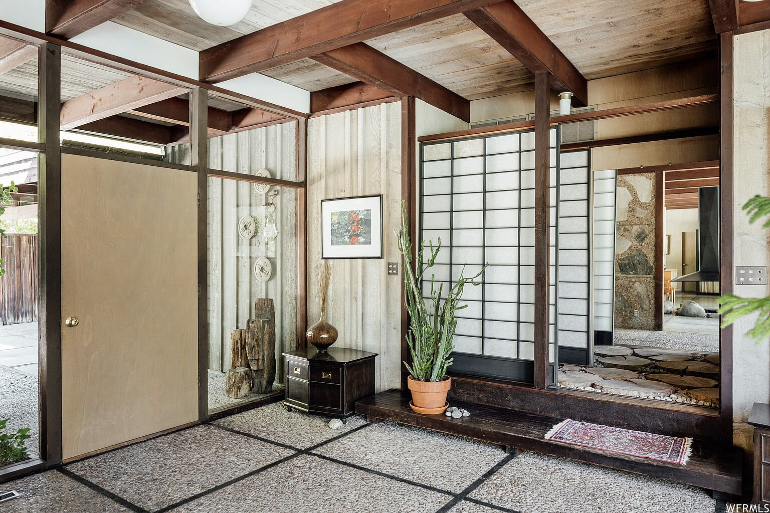 Back in the entryway, a Japanese-style Shoji screen delineates between public and private spaces by separating a hallway that leads to the home's bedrooms.  Photo 7 of 18 in This Tranquil, Japanese-Inspired Midcentury Home Asks $1.2M