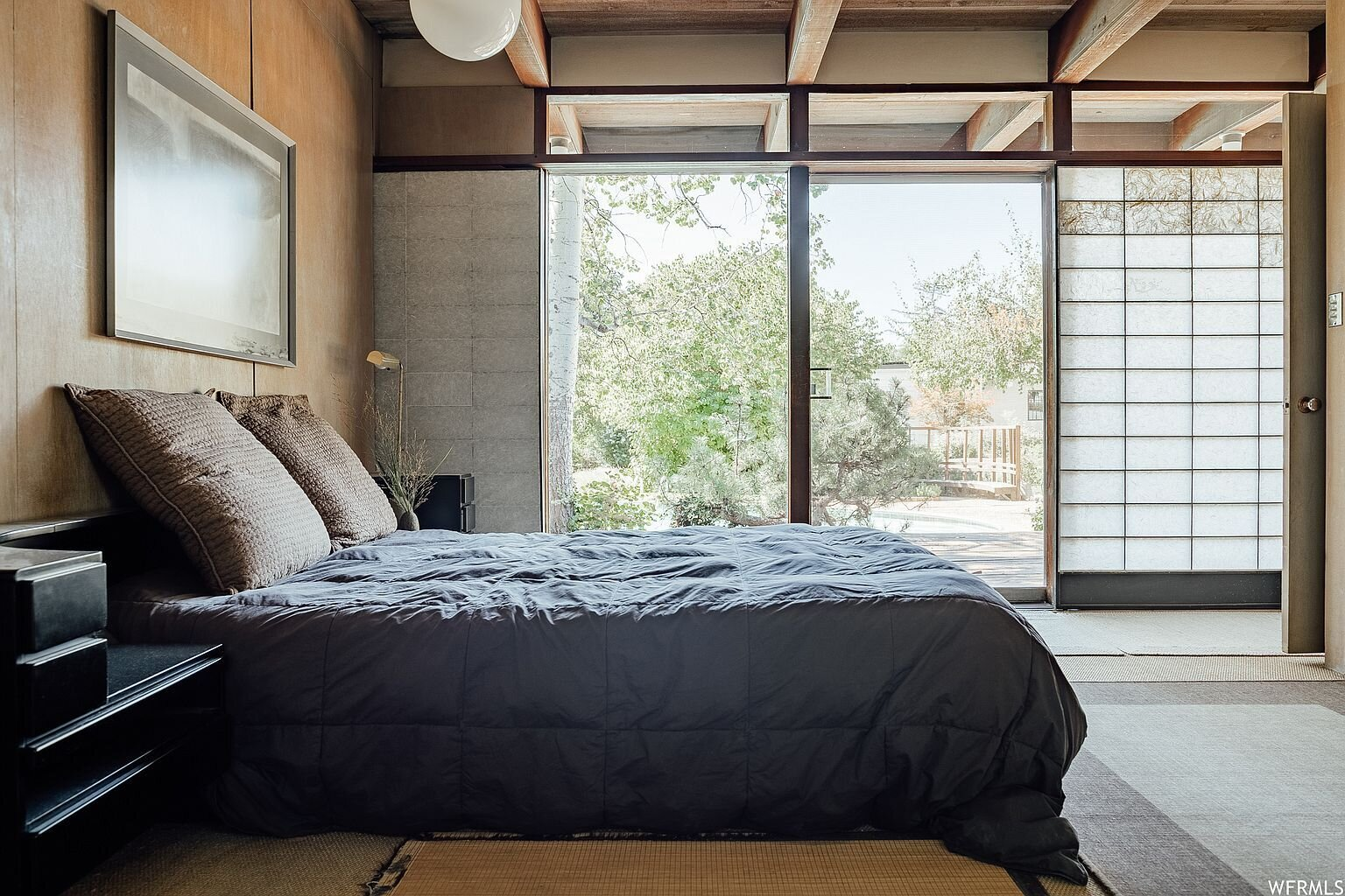 Another view of the bedroom shows more of the screens along the window wall.  Photo 10 of 18 in This Tranquil, Japanese-Inspired Midcentury Home Asks $1.2M