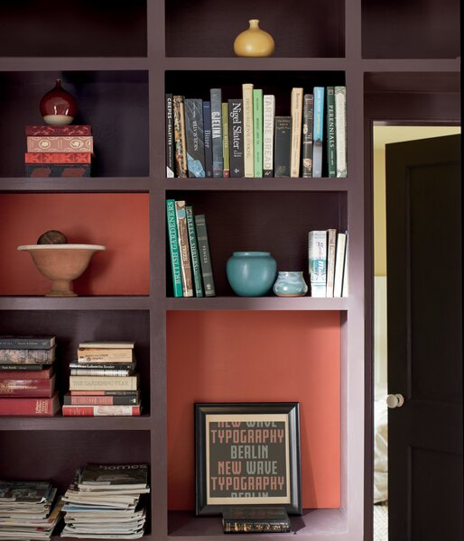 A bookcase is painted in Amazon Soil.