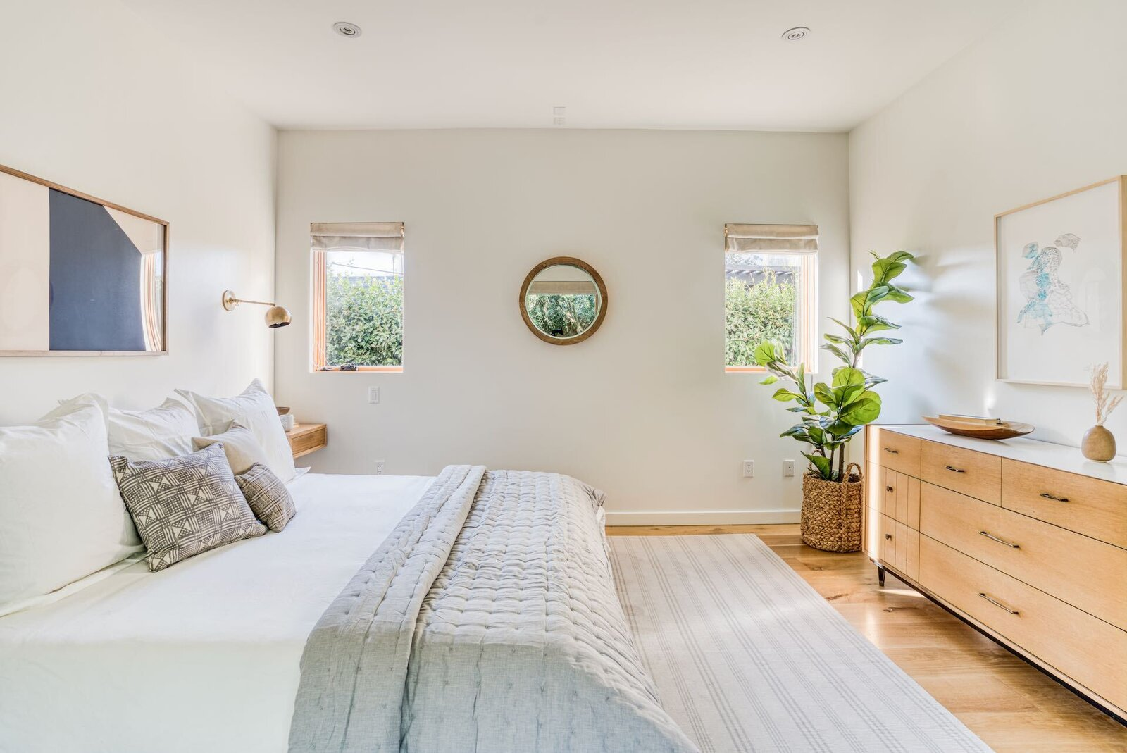 A sunlit principal suite is located at the end of the hallway.  Photo 11 of 15 in In Los Angeles, a Remixed Craftsman Bungalow Lists for $1.9M