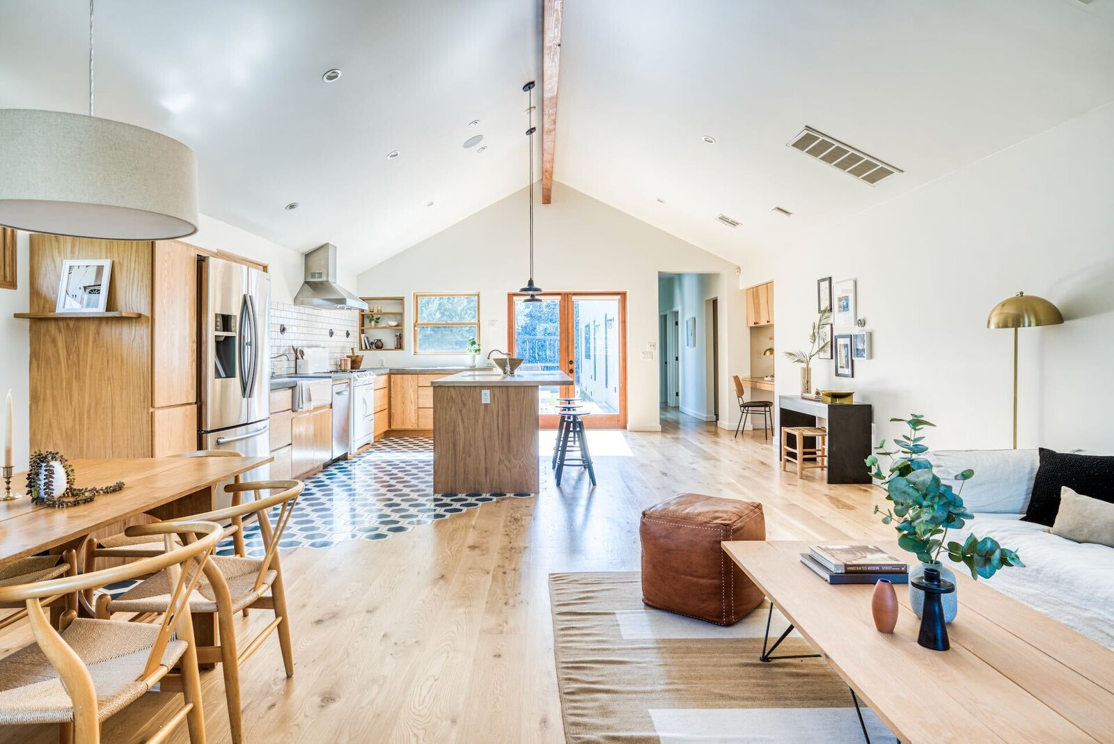 A great room greets you just behind the front door. Wide-plank hardwood floors and a pitched ceiling lead the eye across the unencumbered space.  Photo 2 of 15 in In Los Angeles, a Remixed Craftsman Bungalow Lists for $1.9M