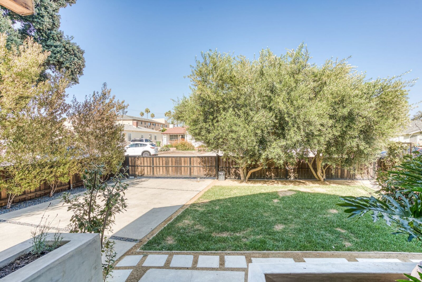 As seen from the front porch, the approximately 5,719-square-foot lot also features a small front lawn set back from the street.  Photo 15 of 15 in In Los Angeles, a Remixed Craftsman Bungalow Lists for $1.9M