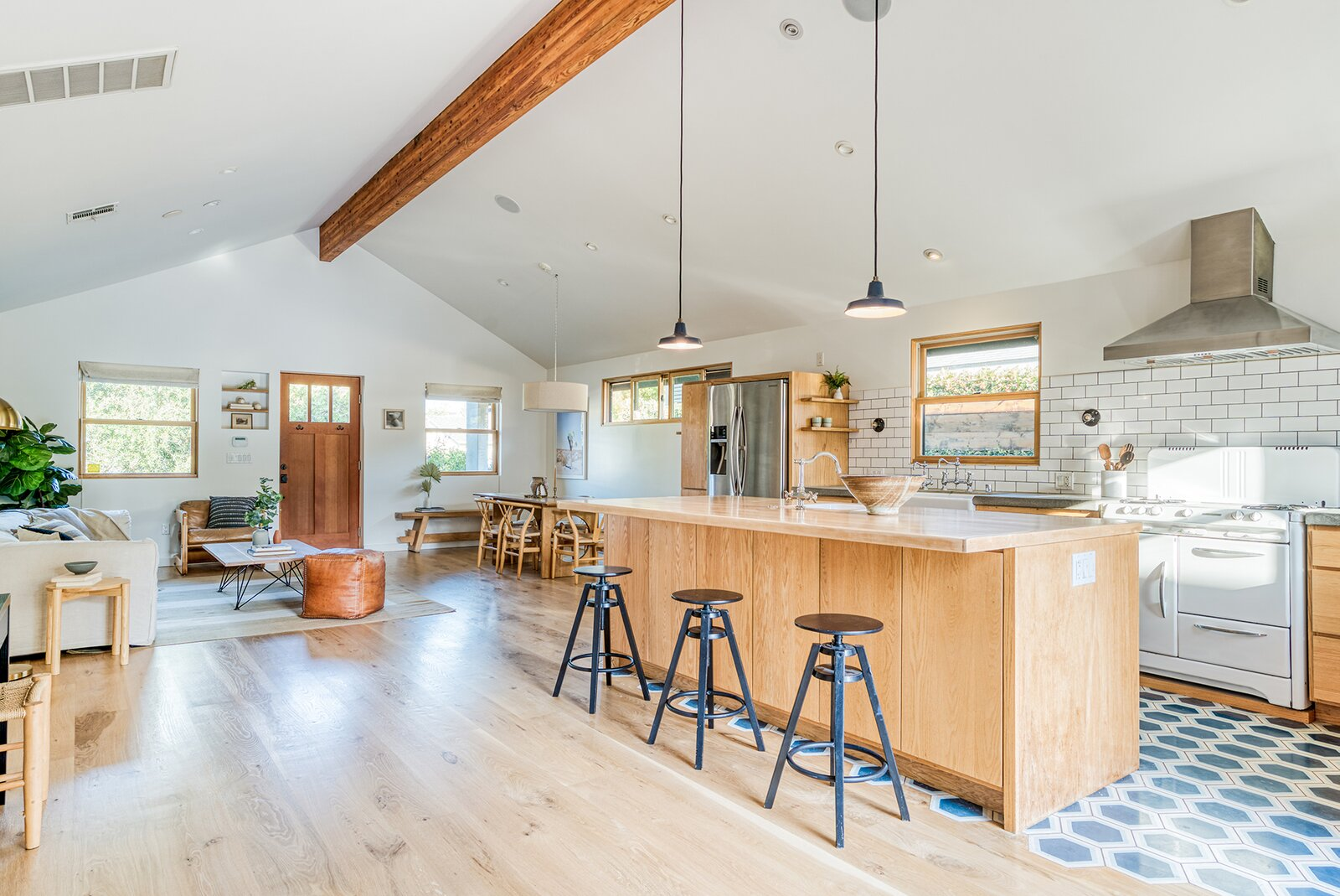 The living, dining, and kitchen areas flow into one another.  Photo 4 of 15 in In Los Angeles, a Remixed Craftsman Bungalow Lists for $1.9M