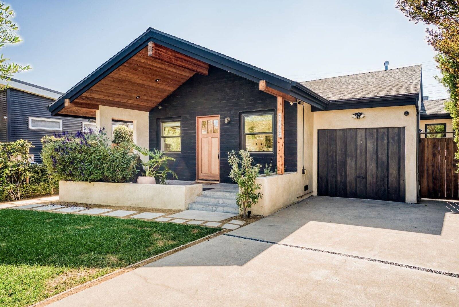 A view of the front facade.  Photo 14 of 15 in In Los Angeles, a Remixed Craftsman Bungalow Lists for $1.9M
