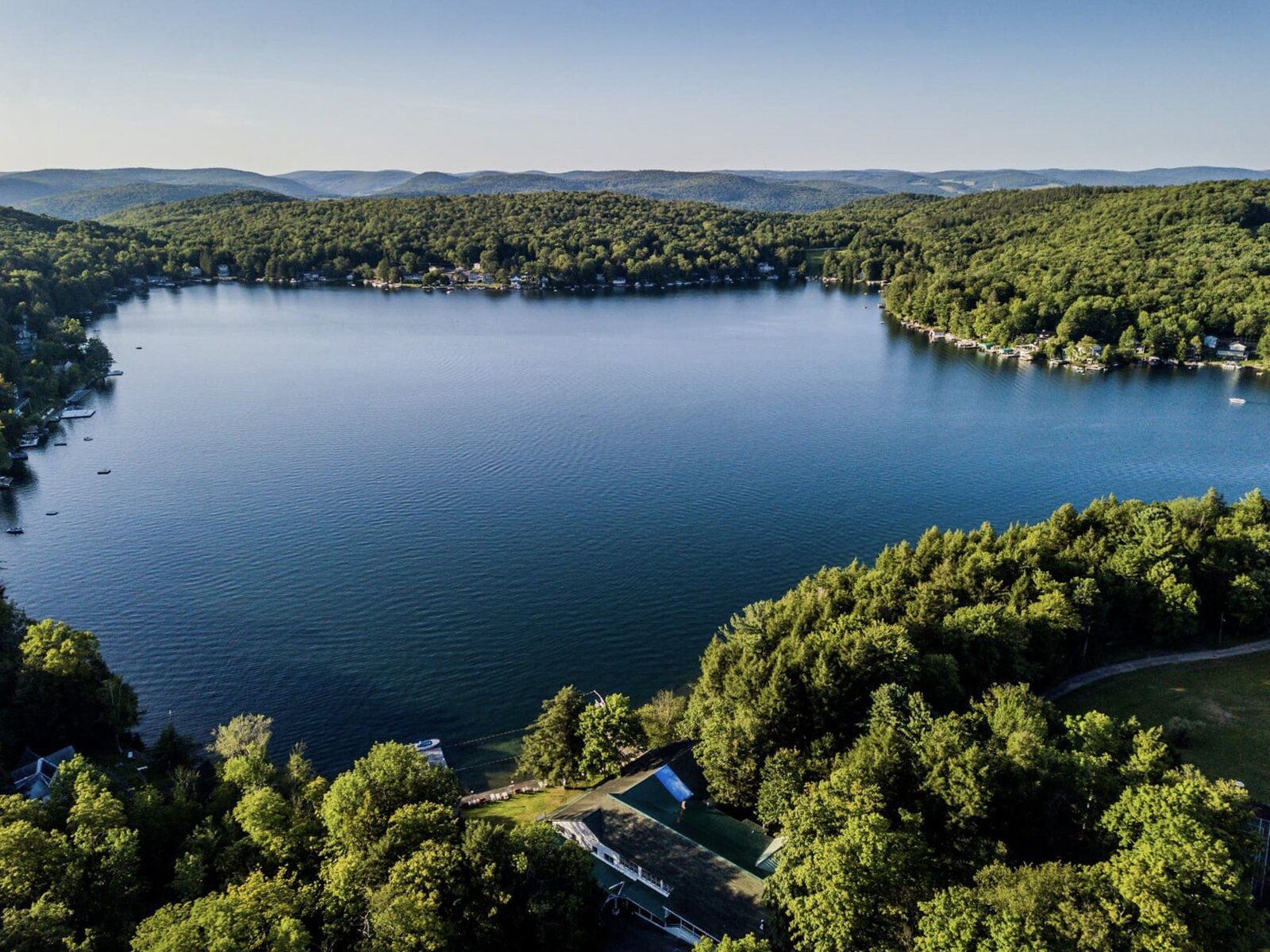 """The quiet, spring-fed lake provides opportunities for a variety of water sports as well.  Photo 16 of 16 in The Lakeside Resort Featured in """"The Marvelous Mrs. Maisel"""" Lists for $6M in Upstate New York"""