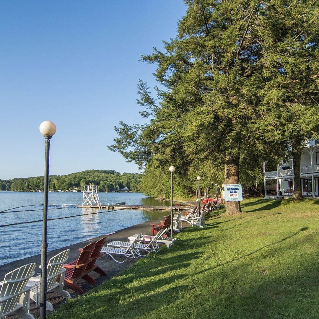 "The lakefront area features several docks, a swimming area, and a boathouse.  Photo 15 of 16 in The Lakeside Resort Featured in ""The Marvelous Mrs. Maisel"" Lists for $6M in Upstate New York"