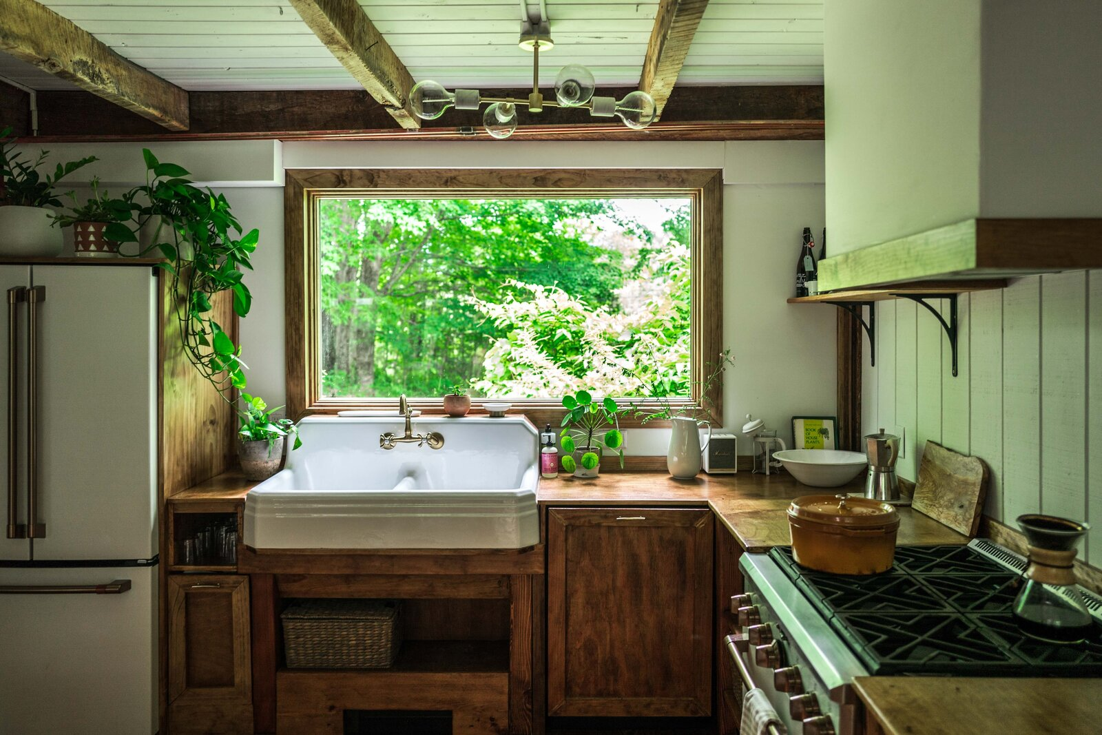 The Hunter Barnhouse by Danielle and Ely Franko kitchen with farmhouse sink
