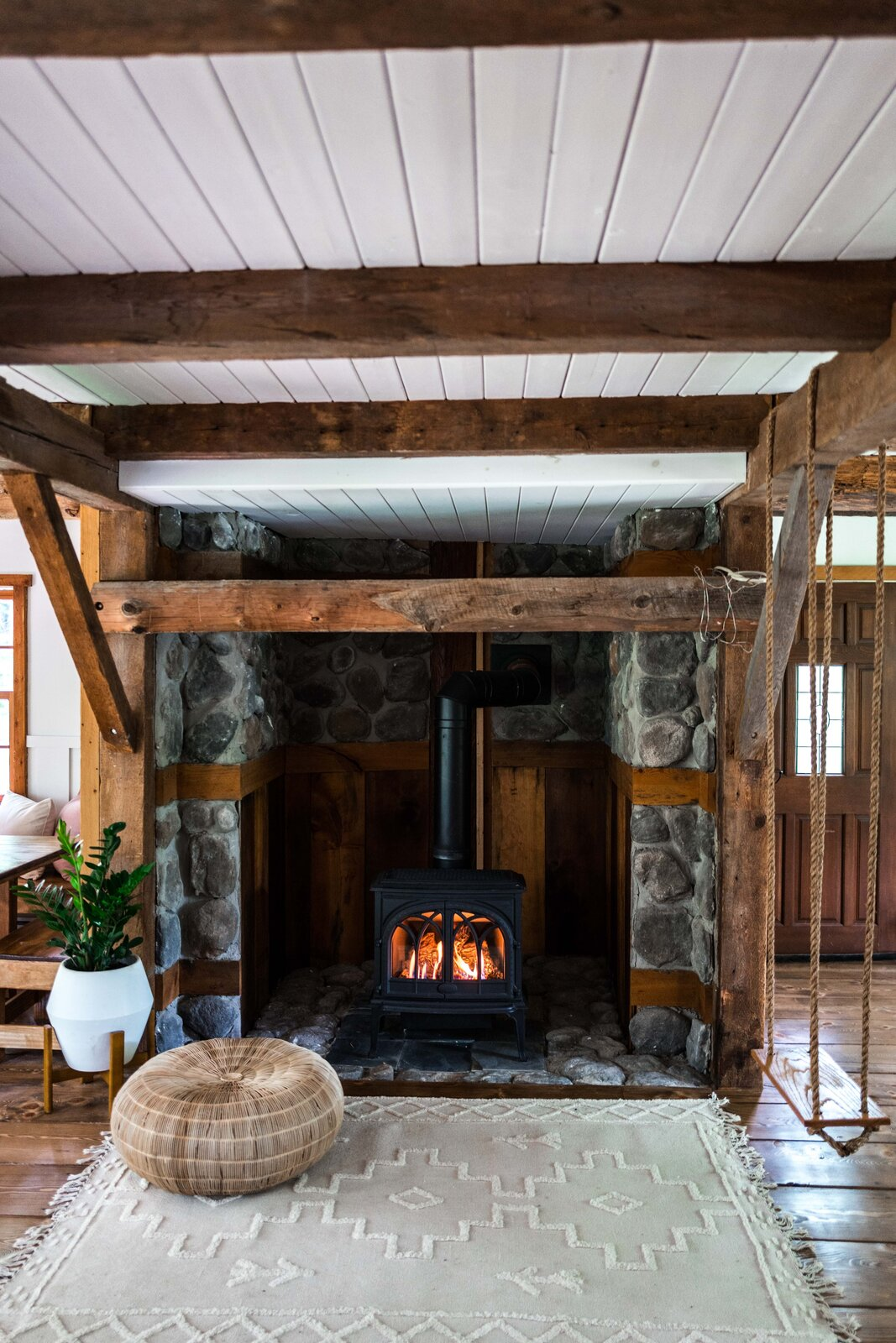 The Hunter Barnhouse by Danielle and Ely Franko wood-burning stove and indoor swing