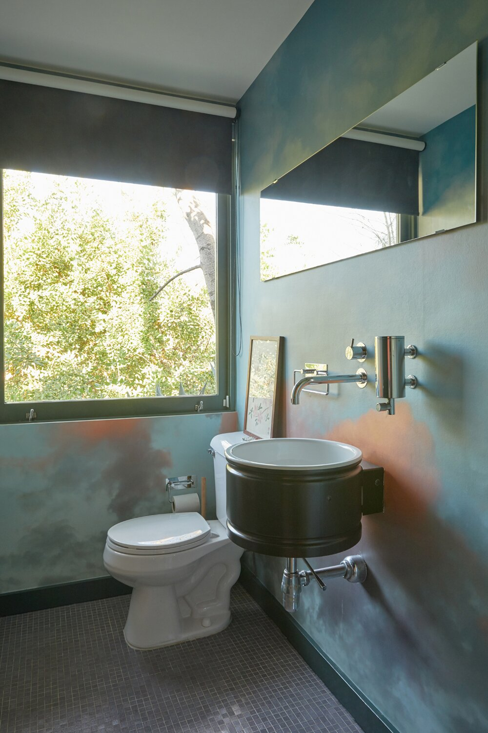 The lower-level half bathroom.  Photo 14 of 17 in A Hilltop Midcentury Under the Hollywood Sign Seeks $3.6M