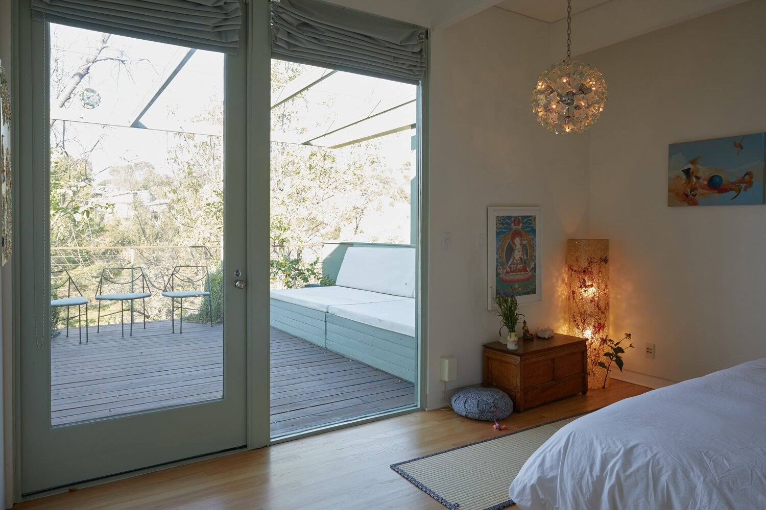 The primary suite provides direct access to the deck.  Photo 8 of 17 in A Hilltop Midcentury Under the Hollywood Sign Seeks $3.6M