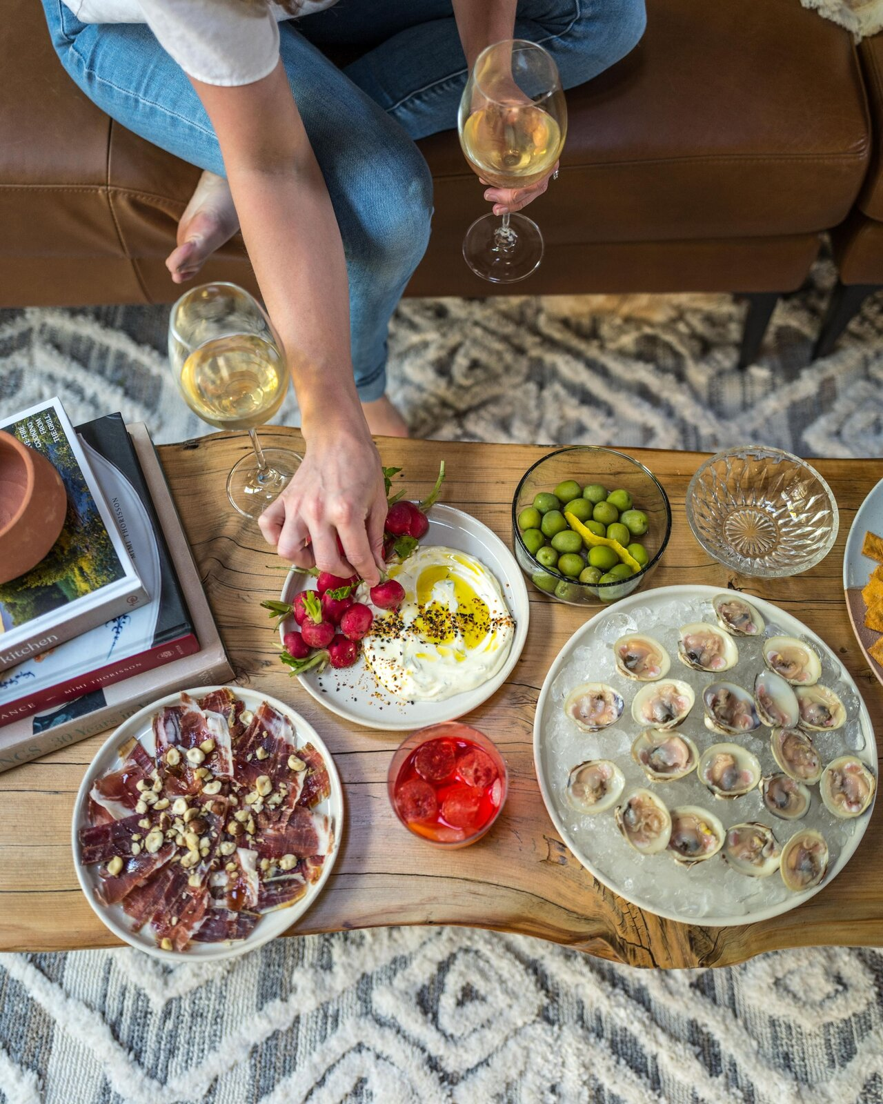 After a hard day's work on the house, Danielle and Ely treated themselves to oysters and charcuturie.  Photo 18 of 19 in Budget Breakdown: A DIY Couple Turn an Aging Barn House Into a Dreamy Catskills Getaway for $55.6K