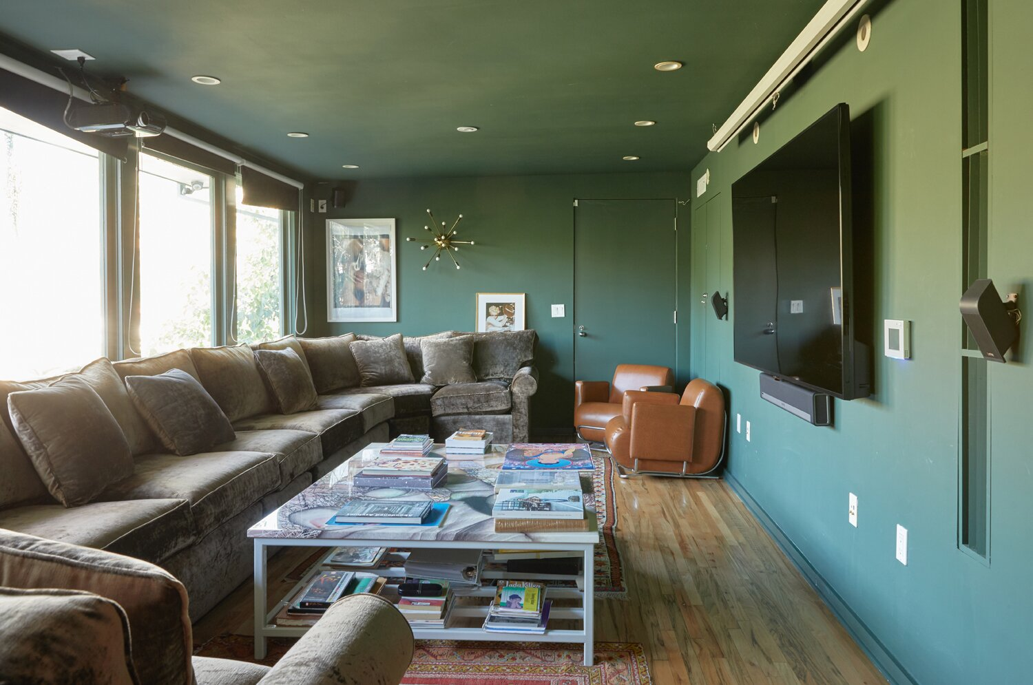 Accessible via a private entrance, another lower level space is currently used as a family room.  Photo 13 of 17 in A Hilltop Midcentury Under the Hollywood Sign Seeks $3.6M