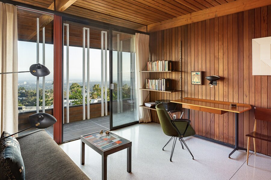 Another bedroom is currently staged as home office and also provides direct access to the covered outdoor area.  Photo 10 of 12 in An Impeccably Renovated Midcentury by Case Study Architect Craig Ellwood Asks $3.75M