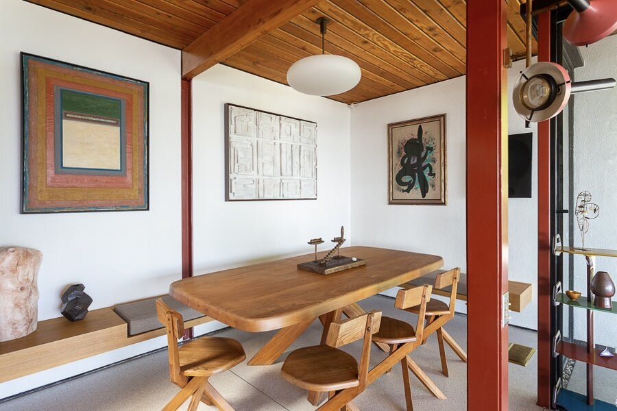 In a corner off of the living area, a built-in bench surrounds a dining table.  Photo 5 of 12 in An Impeccably Renovated Midcentury by Case Study Architect Craig Ellwood Asks $3.75M