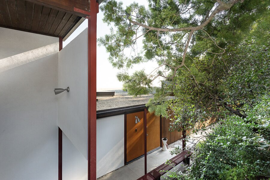 The Byron Lamar Johnson House in Brentwood, California, was completed at the forefront of Craig Ellwood's successful career as a home designer and builder in the Los Angeles area. The structure spreads out horizontally along the hillside, with only a carport visible from the street.  Photo 1 of 12 in An Impeccably Renovated Midcentury by Case Study Architect Craig Ellwood Asks $3.75M