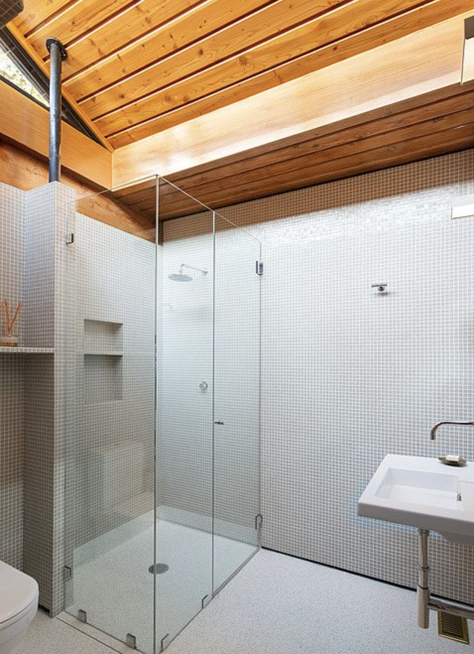 A look at one of the home's four full bathrooms, all of which have been modernized with new flooring, tile, and fixtures.  Photo 9 of 12 in An Impeccably Renovated Midcentury by Case Study Architect Craig Ellwood Asks $3.75M