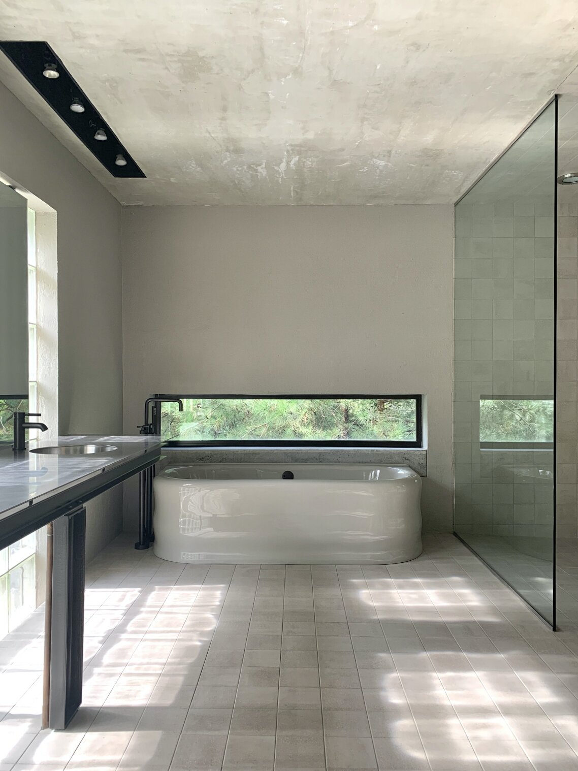 "A look at one of the home's two full bathrooms. The space features <span style=""font-family: Theinhardt, -apple-system, BlinkMacSystemFont, &quot;Segoe UI&quot;, Roboto, Oxygen-Sans, Ubuntu, Cantarell, &quot;Helvetica Neue&quot;, sans-serif;"">imported Dutch ceramic tile, Clark's custom vanity design supported by steel girders, and a reproduction of a 1930s bathtub custom cast in England.</span><span style=""font-family: Theinhardt, -apple-system, BlinkMacSystemFont, &quot;Segoe UI&quot;, Roboto, Oxygen-Sans, Ubuntu, Cantarell, &quot;Helvetica Neue&quot;, sans-serif;""> </span>  Photo 9 of 12 in Surrounded by a Marshy Forest, This Fortress-Like Home Asks $1.7M in Virginia"