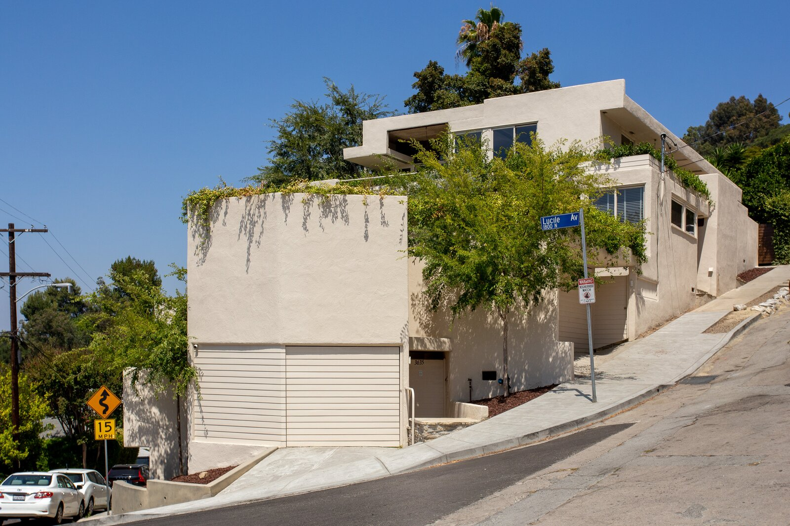 An exterior view shows the corner of the building, which sits on a triangular-shaped lot along Carnation Avenue and Lucile Avenue in Silver Lake. Krisel's pergola design has since been removed from one of the terraces.  Photo 13 of 14 in A Newly Restored Schindler Building Lists for $3.65M in L.A.