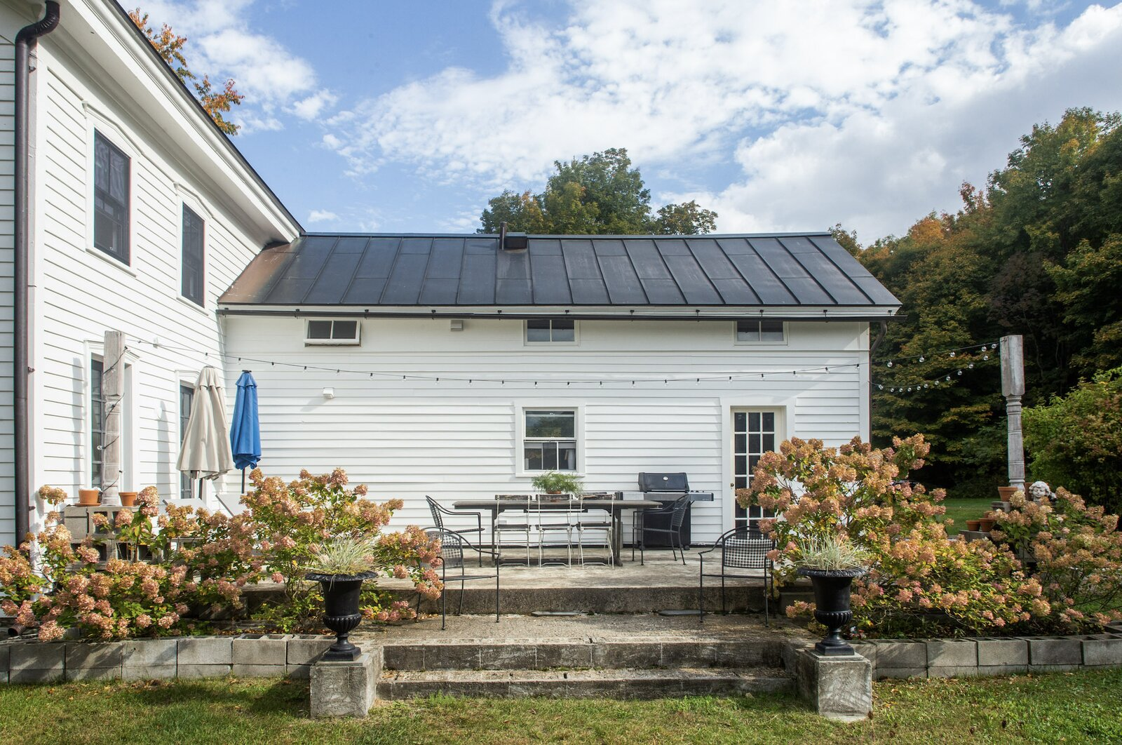 On the other side of the home, a large patio extends from the kitchen and living area.  Photo 13 of 14 in For $795K, This 1865 Greek Revival Farmhouse Could Be Your Escape From New York