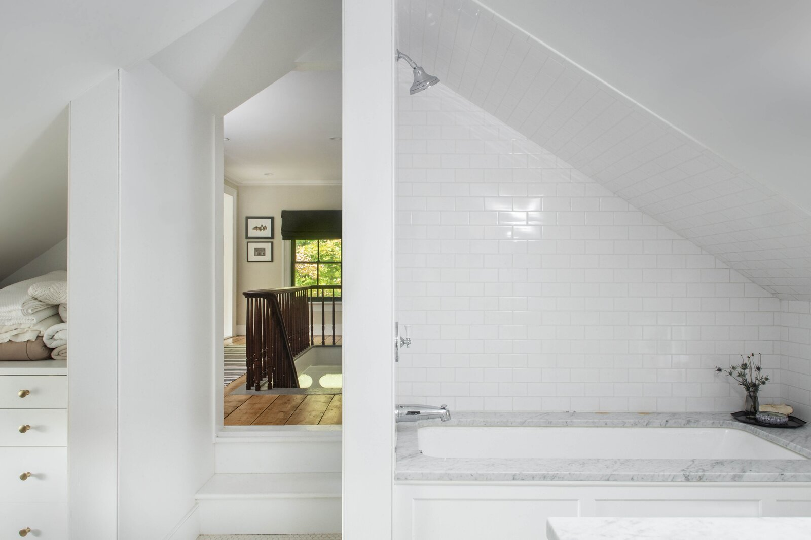 Located above the kitchen, one of the home's two full bathrooms opens from the staircase landing. The  Photo 7 of 14 in For $795K, This 1865 Greek Revival Farmhouse Could Be Your Escape From New York