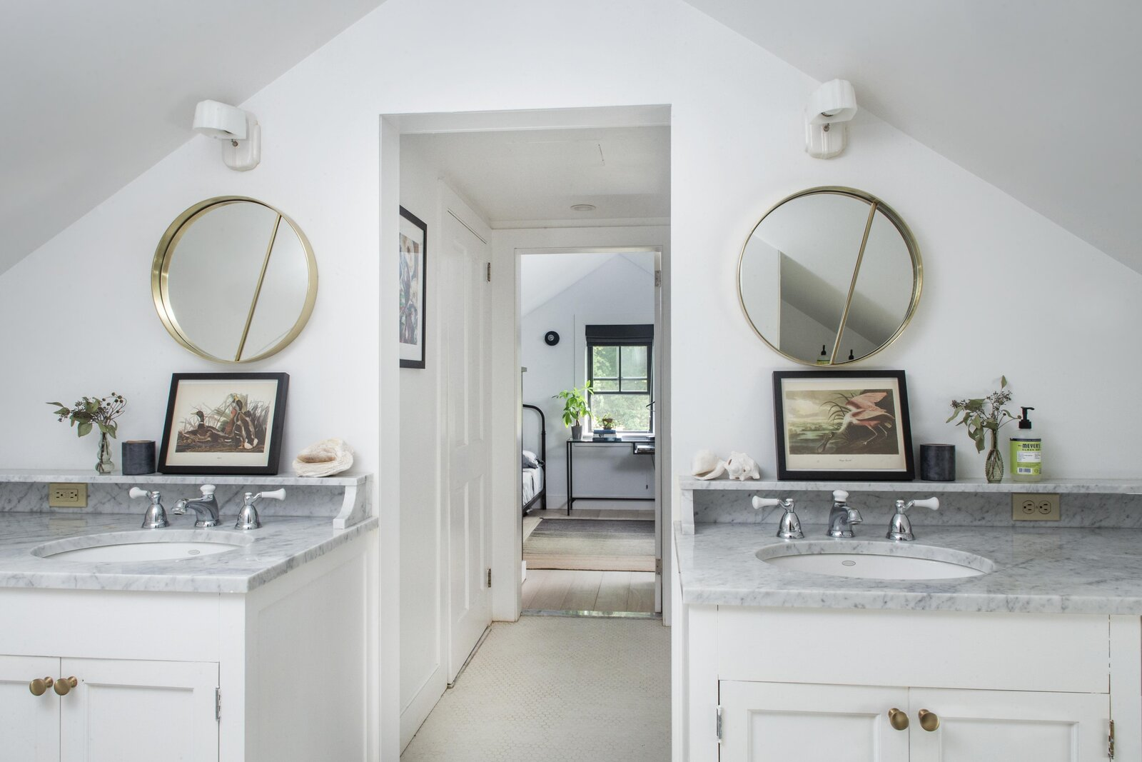The opposite side of the bathroom features matching vanities and a central hallway leading to a bedroom in the back.  Photo 8 of 14 in For $795K, This 1865 Greek Revival Farmhouse Could Be Your Escape From New York