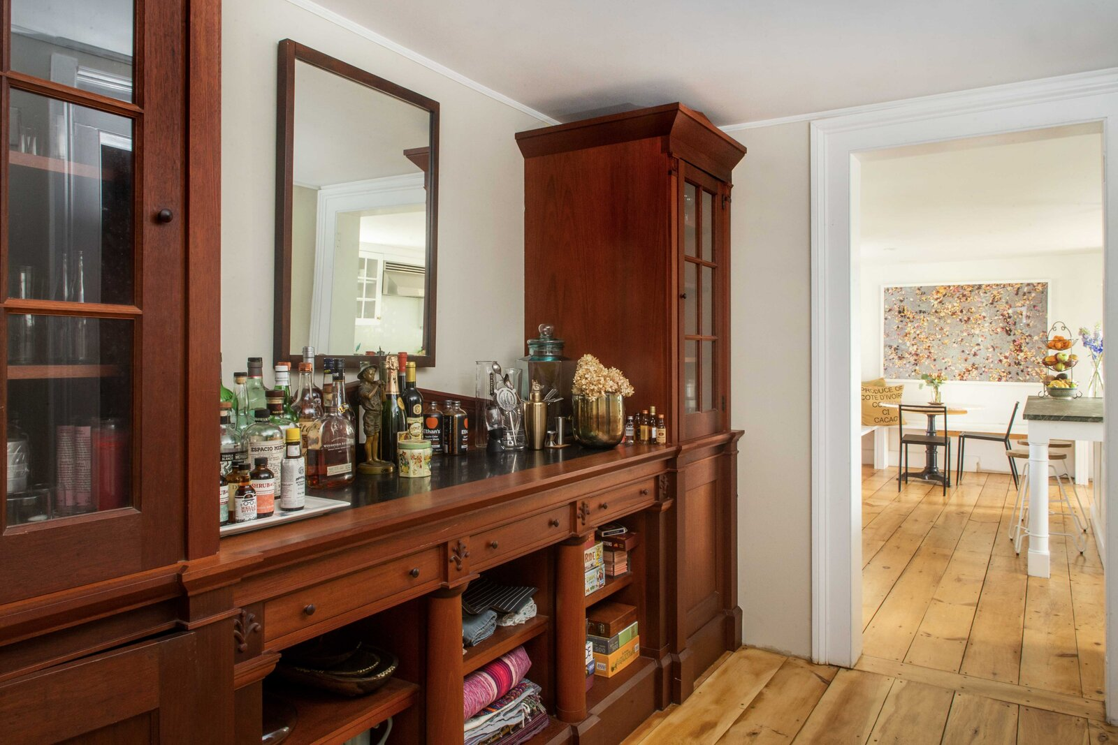 A hallway with built-in cabinetry connects the old and new sections of the home.  Photo 5 of 14 in For $795K, This 1865 Greek Revival Farmhouse Could Be Your Escape From New York