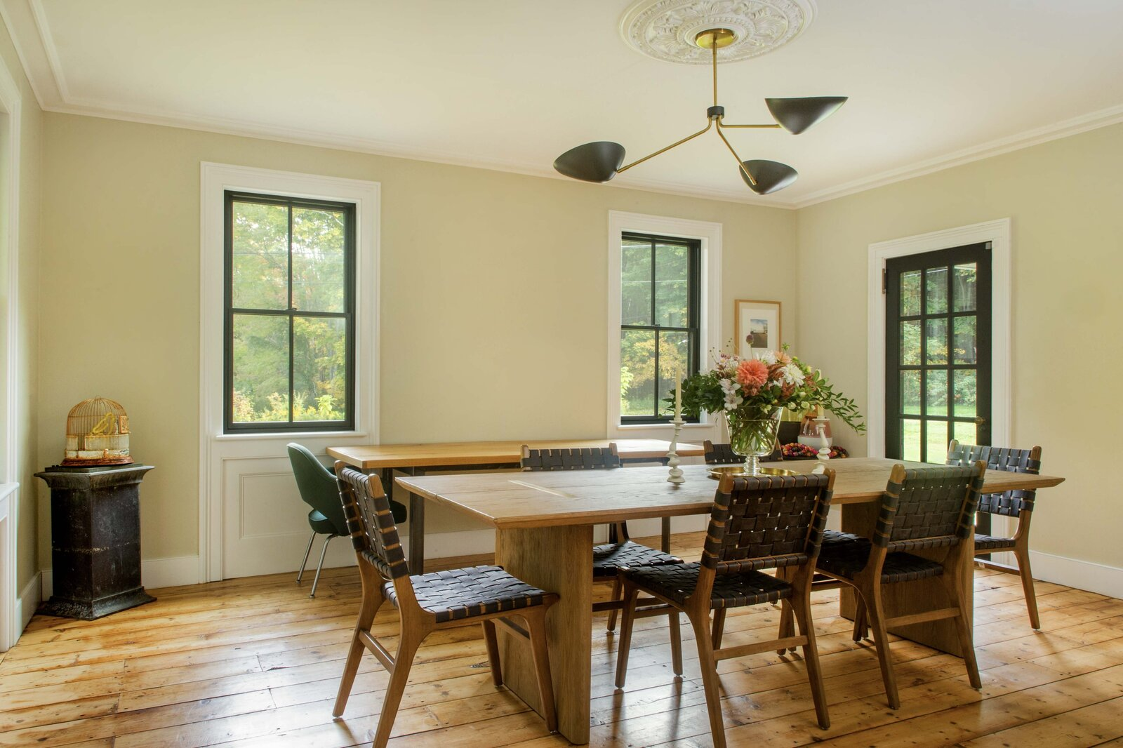 The spacious formal dining area boasts nine-foot ceilings, as well as original hardwood floors and moldings. A French door leads out to the covered porch.  Photo 2 of 14 in For $795K, This 1865 Greek Revival Farmhouse Could Be Your Escape From New York