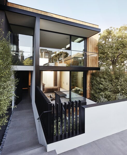 This contemporary home designed by MAK Studio is now up for sale in San Francisco's Dolores Heights neighborhood. A gated parking pad in front of the structure is bordered by a walkway from the street, which leads down past a sunken patio and living wall to the main entrance.