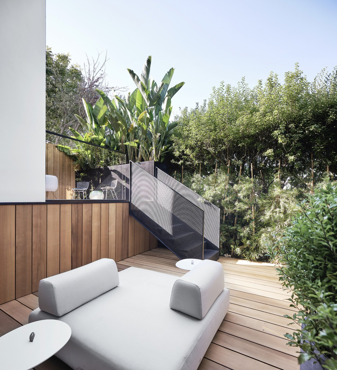 Outside, a bi-level rear deck is clad in Western Red Cedar and surrounded by lush plantings.  Photo 17 of 19 in This Radiant San Francisco Residence Hits the Market at $6.8M